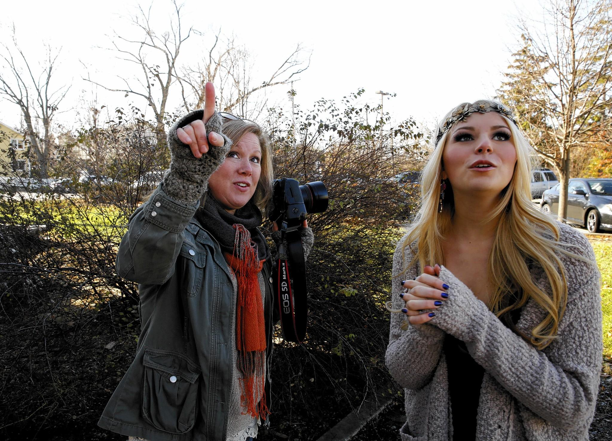Alicia Johnson, owner of Alicia's Photography, works with Naperville North High School senior Magee Campana, 17, of Naperville, on a portrait shoot.