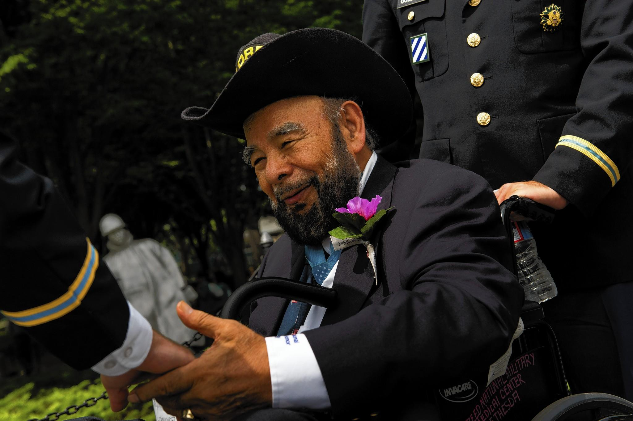 Rudy Hernandez greets friends at an event commemorating the 60th anniversary of the Korean War on July 27, 2013, in Washington, D.C. President Truman awarded him the Medal of Honor in April 1952.