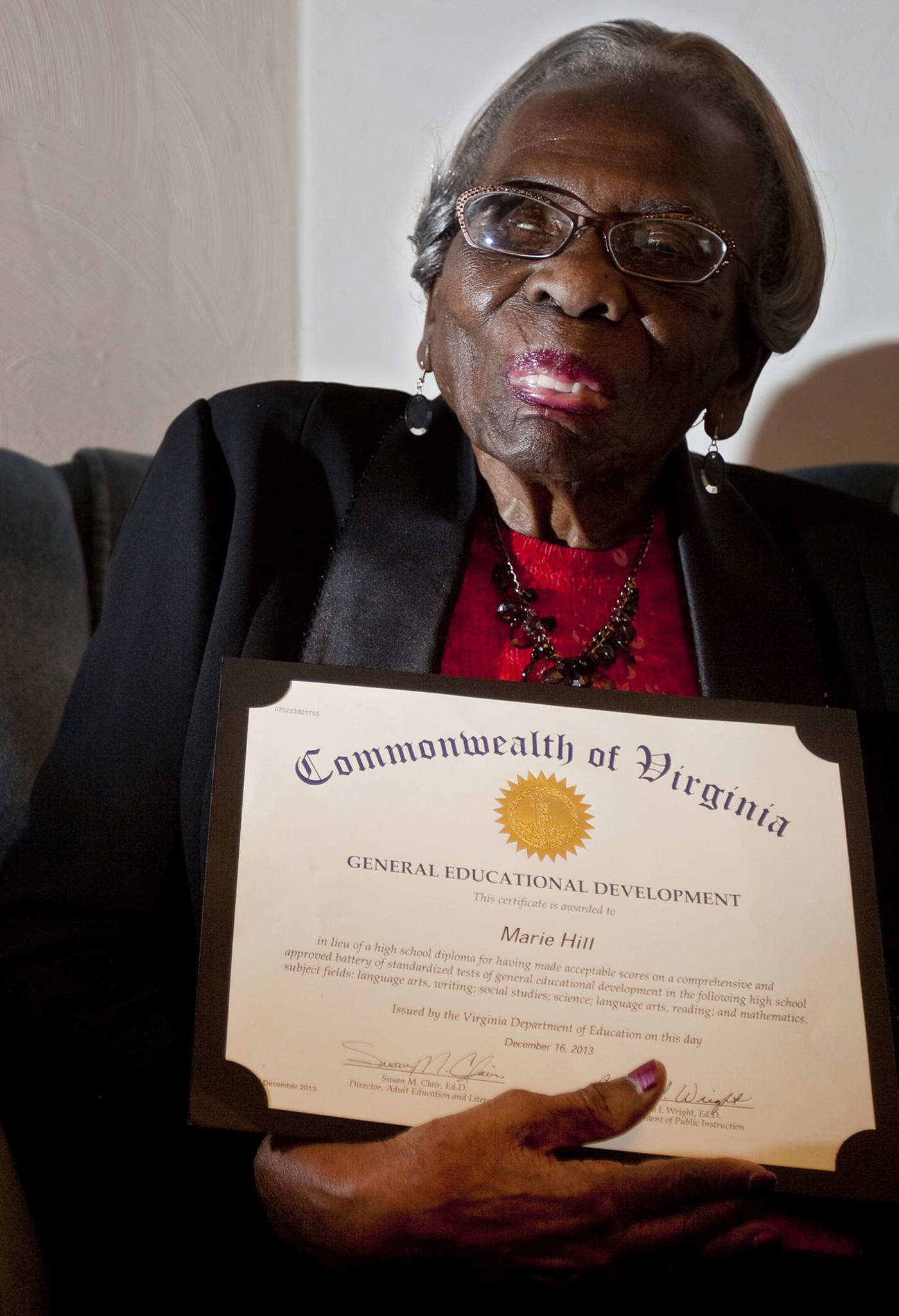 Lifelong Suffolk resident Marie Hill, 92, earned her GED in December?eight decades after she dropped out of school in the seventh grade.