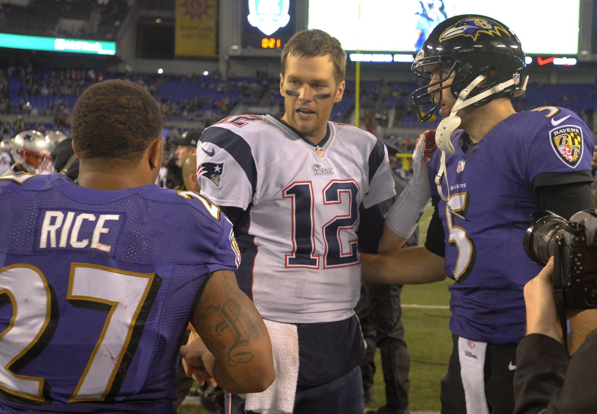 New England Patriots quarterback Tom Brady greets Baltimore Ravens running back Ray Rice (27) and quarterback Joe Flacco (5), after the Patriots defeat the Ravens 41-7 in their game in Baltimore on Dec. 22, 2013.