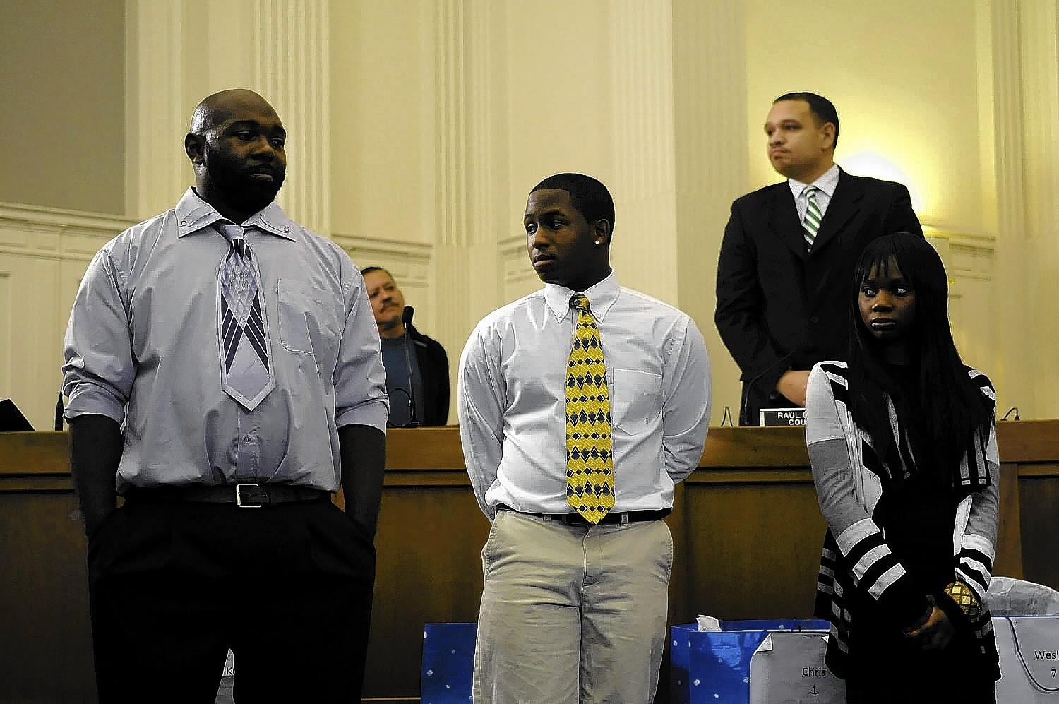 The city honored, left to right, Lamonte Coleman, Christopher Brown and Antwana Tulley for their quick action last week when they saved four adults and 13 children that escape unharmed from a burning building in Hartford. Coleman, a neighbor, knew that Rosemarie Gooden, who is disabled, was still on the second floor of the building. He ran inside and carried her out despite the flames. Tulley lifted 7 of her siblings out a first floor window and brought them to safety while Brown, who lives on the second floor, led his sister outside and also alerted the third-floor residents to the fire. All three were honored at the start of the council meeting at city hall and donated Christmas gifts were given to all the displaced children afterward.