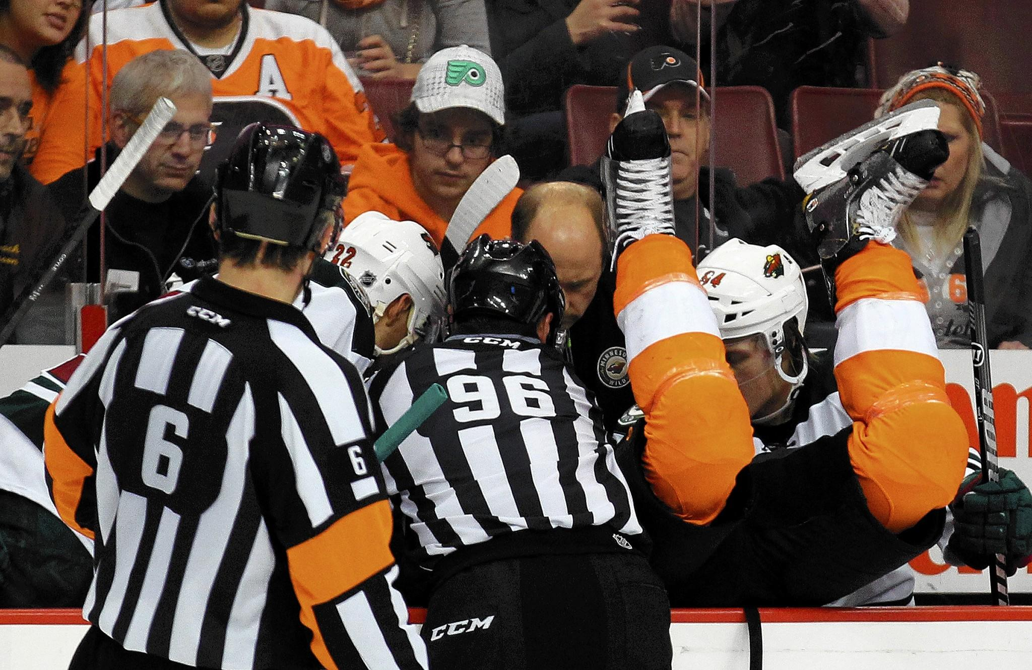The Philadelphia Flyers' Brayden Schenn goes into the Minnesota Wild bench during the third period at the Wells Fargo Center in Philadephia.