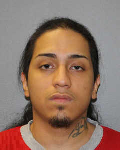 Carlos Burgos was charged with stabbing an employee at TJ Maxx in Hamden.