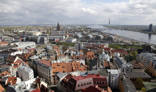 A hand-to-hand book transfer from an old library to a new one begins Riga's co-reign as a European Capital of Culture 2014. Above: A general view of Riga Old City May 4, 2011.