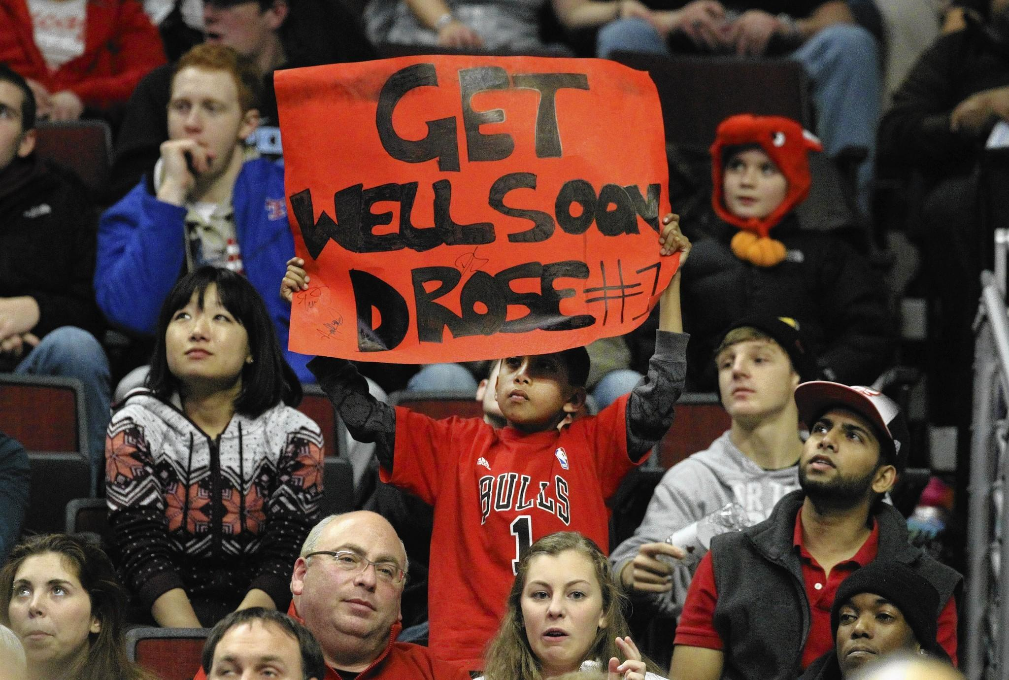 A Bulls fan has a few words of encouragement for injured point guard Derrick Rose at the United Center last week.