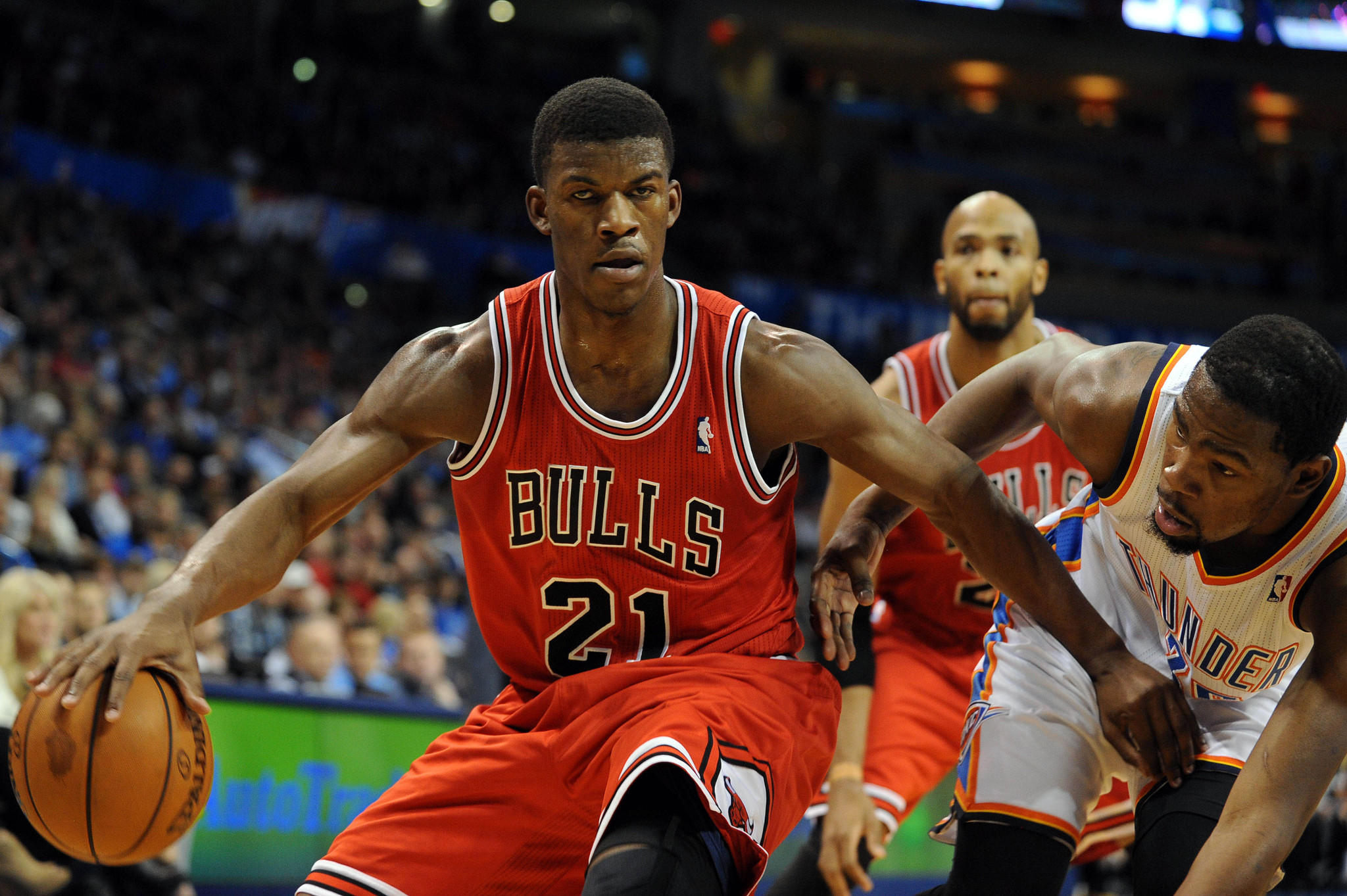 Jimmy Butler drives on Kevin Durant during the second quarter at Chesapeake Energy Arena.
