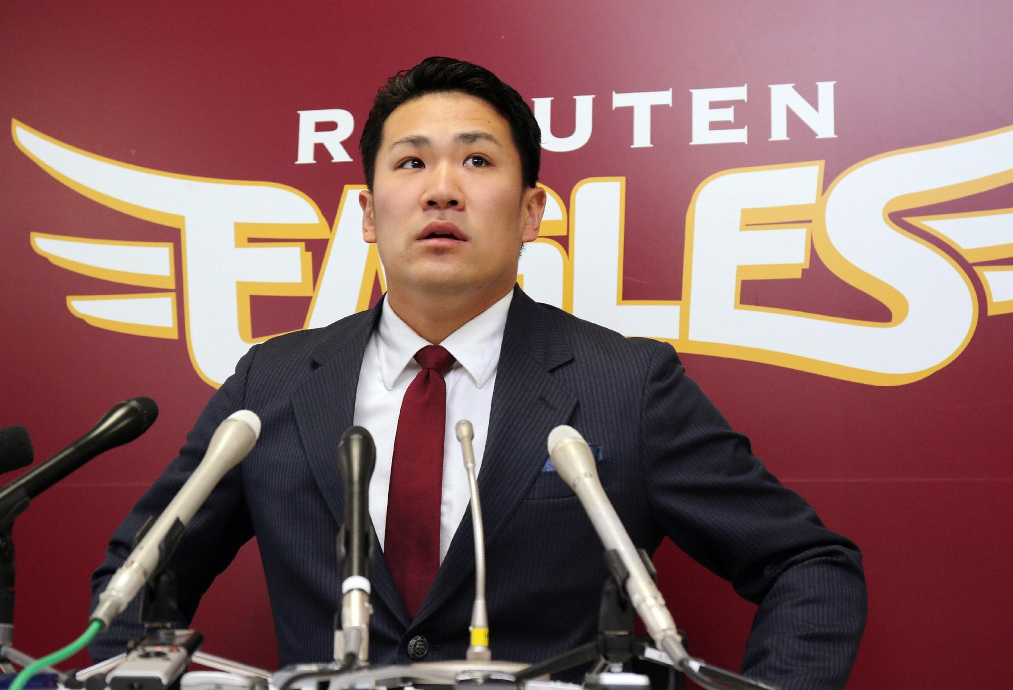 Japanese star pitcher Masahiro Tanaka of Rakuten Eagles speaks before the press after meeting with his team's president.