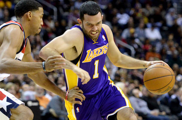 The Lakers will play for the first time in two weeks with a point guard when Jordan Farmar (1) makes his return against the Miami Heat on Wednesday.