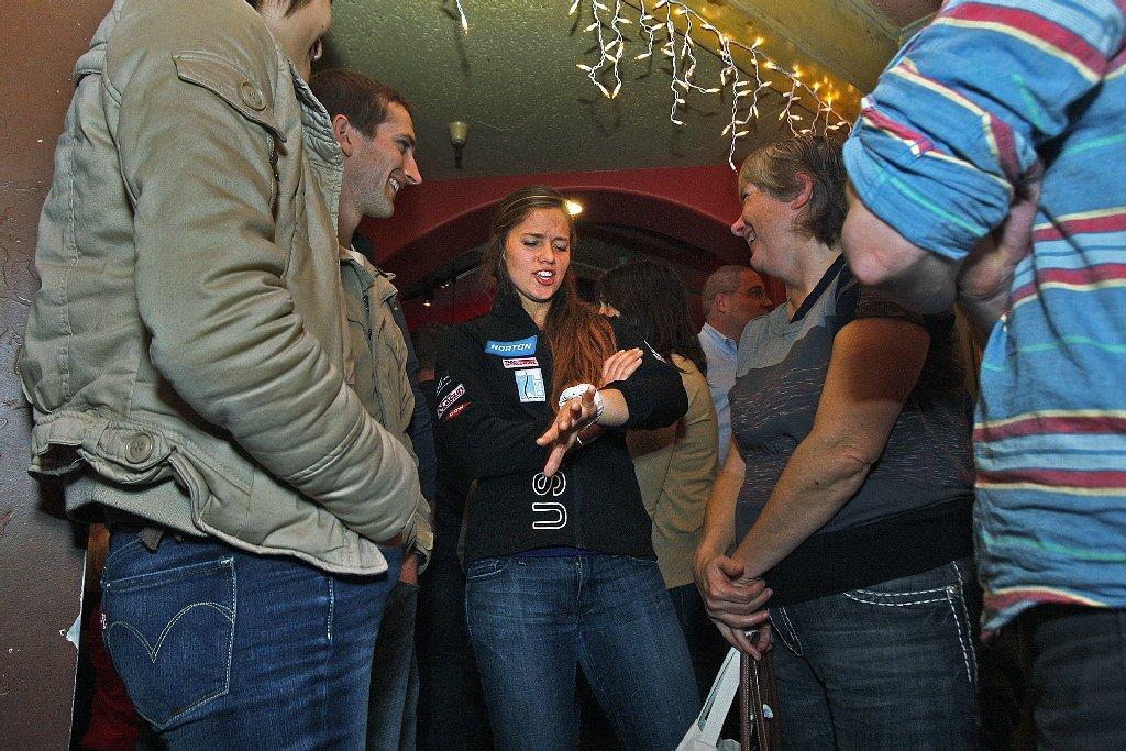 Kate Hansen, who will compete in the luge in the wither Olympics in Sochi greets and thanks supporters at Los Gringos Locos in La Canada Flintridge on Monday. (Tim Berger/Staff Photographer)