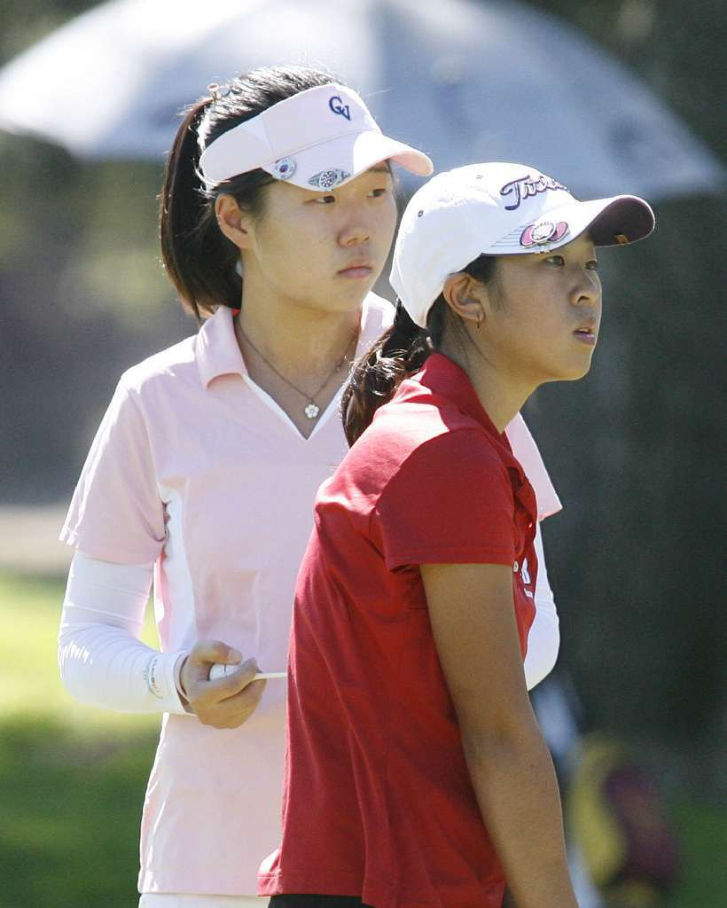 Crescenta Valley's Audrey Chung, left, and Burroughs' Joany Gao were both named to the All-Area girls' golf first team. (Tim Berger/File Photo)