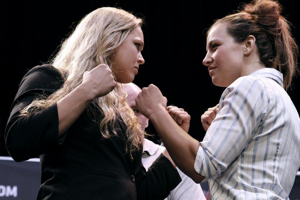 UFC champion Ronda Rousey, left, is looking to defeat top contender Miesha Tate for a second time. (Raul Roa/File Photo)