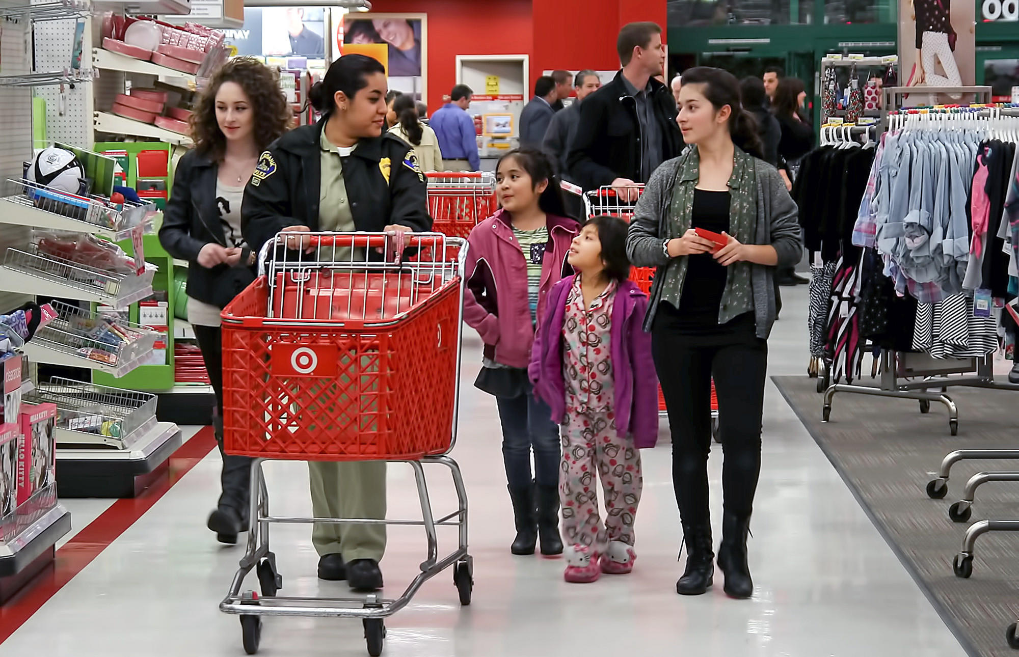 "Police cadet Magdalena Bautista takes a group to the toy aisles as part of the annual ""Heroes and Helpers"" event put on by Burbank Police officers, Explorers, cadets and volunteers along with the Burbank Noon Rotary club at theTarget in the Empire Center on Thursday, December 19, 2013. The kids were given gift cards and went through the store picking gifts for family members."