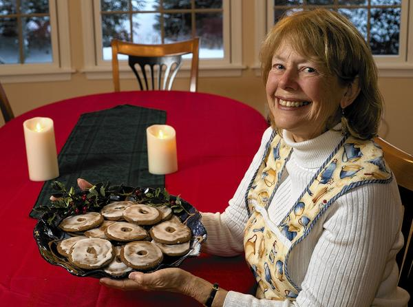 Donna Holton of Bethlehem holds a platter of cookies baked from her grandmother's recipe.