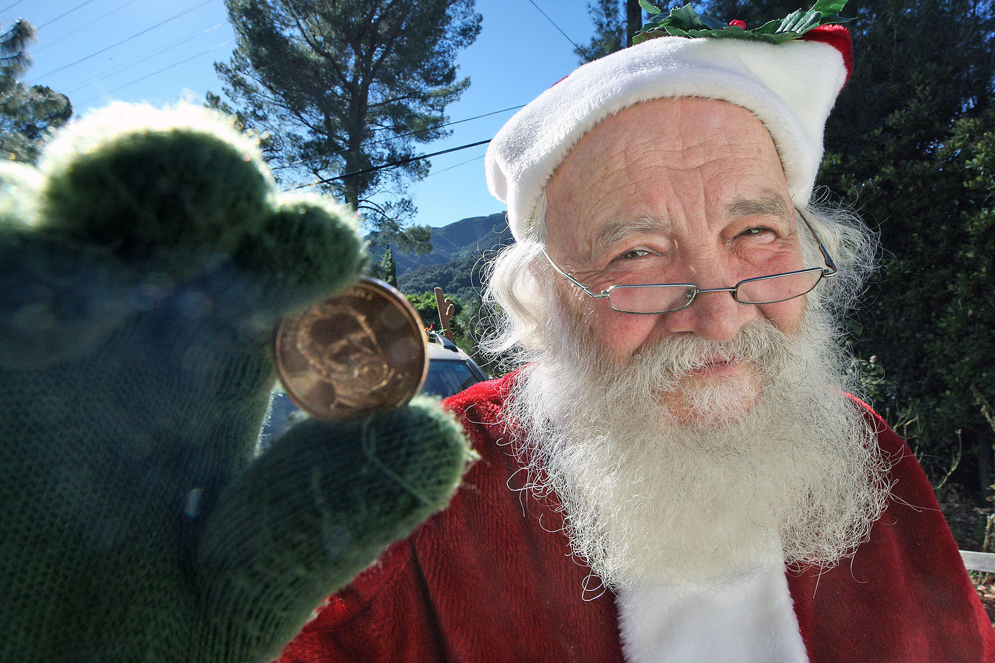 La Crescenta resident Joe Mandoky dresses up every year as Santa and hands out golden dollars to people who say they believe in Santa Claus. Photographed on Monday, December 23, 2013.