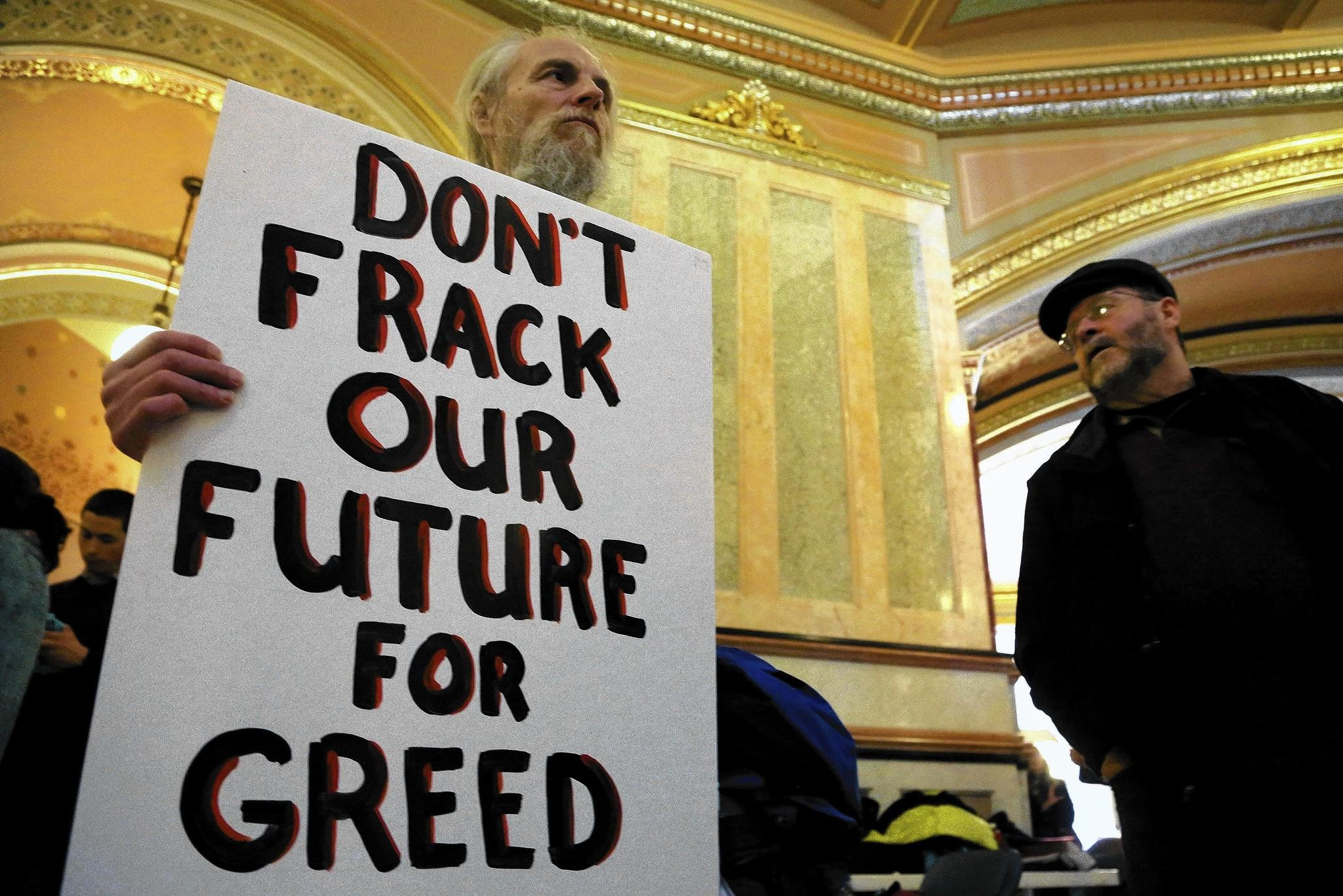Gregg Brown protests at the Illinois Capitol in Springfield in support of a moratorium on fracking.