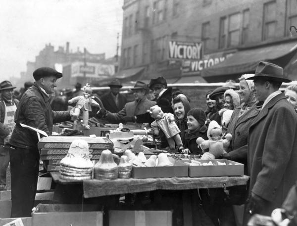 From Chicago's Christmas past: A Maxwell Street vendor sells ornaments and dolls on Christmas Eve 1944.