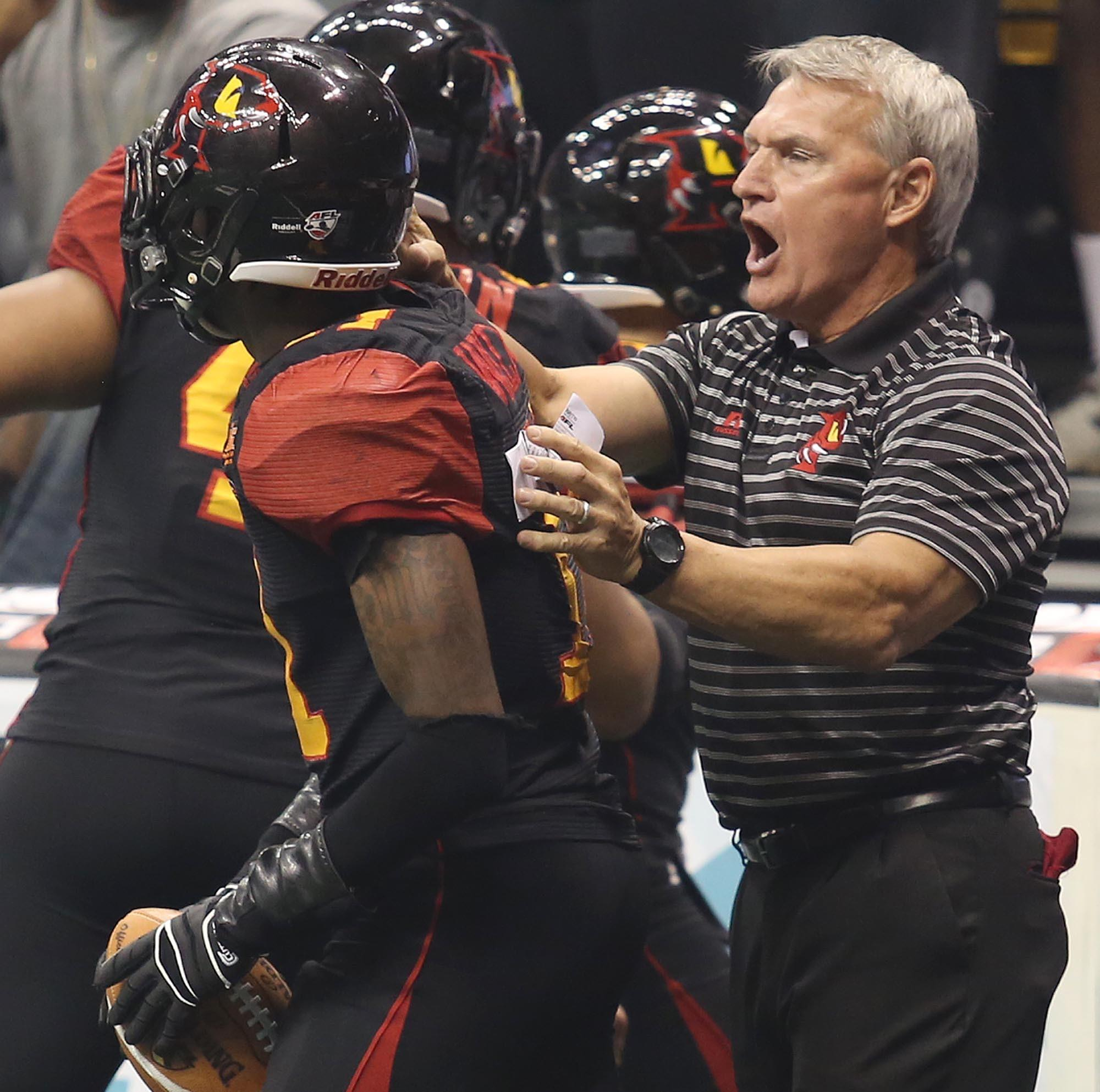 Former Orlando head coach Doug Plank, right, congratulates wide receiver Maurice Williams, left, after a touchdown during the New Orleans VooDoo at Orlando Predators AFL game at the Amway Center in Orlando on Saturday, July 27, 2013.