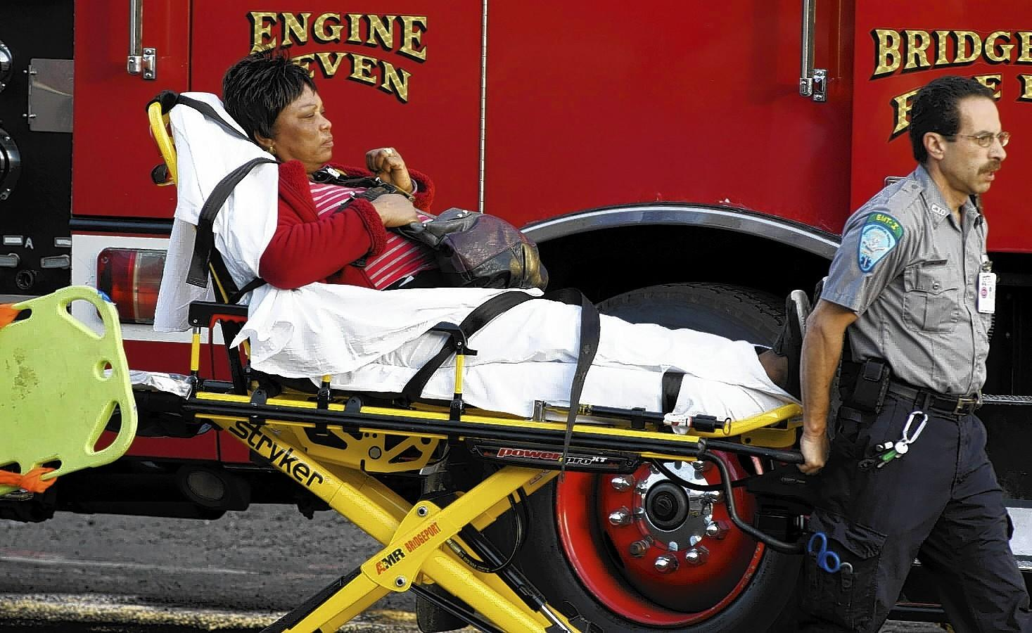 A woman is transported to the hospital after two commuter trains collided in Bridgeport, Connecticut May 17, 2013. Some 20 to 25 people were injured on Friday when two trains collided on a commuter line near Fairfield, Connecticut, but there were no reports of fatalities, police and transit authorities said on Friday. The accident occurred when an eastbound train on the Metro North Railroad derailed and collided with a westbound train near Fairfield, said Metropolitan Transit Authority spokesman Aaron Donovan.