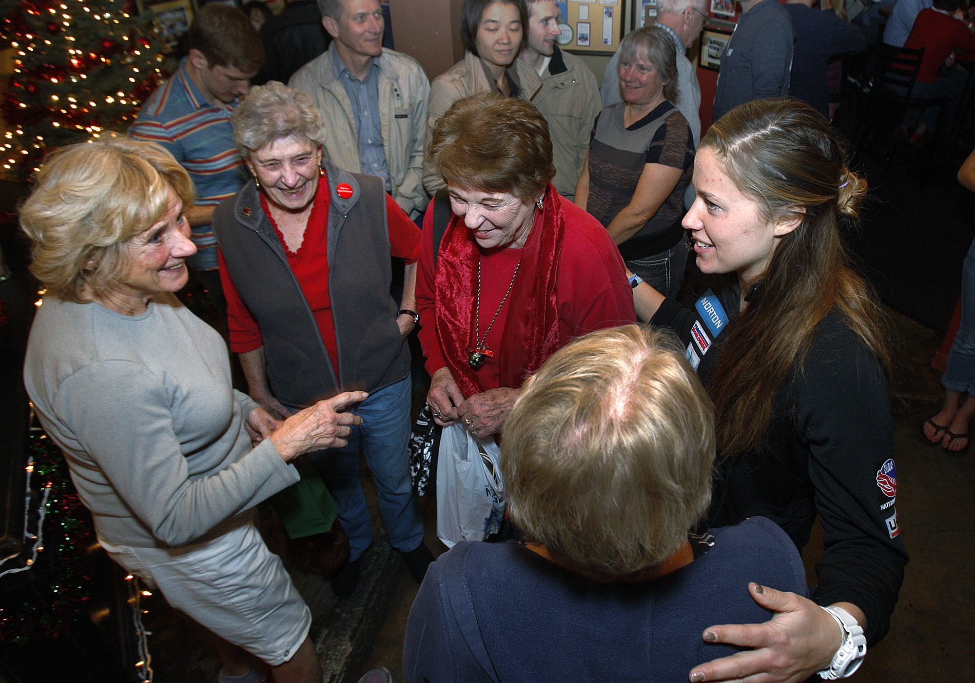 Kate Hansen, right, competing in the luge in the wither Olympics in Sochi, greets and thanks supporters, including Cynthia Smithers, of La Canada Flintrdge, Toni Brooks, of Pasadena, Ann Neilson, of La Canada Flintrdige and Claudia Beach, (back to camera) at Los Gringos Locos in La Canada Flintridge on Monday, December 23, 2013.
