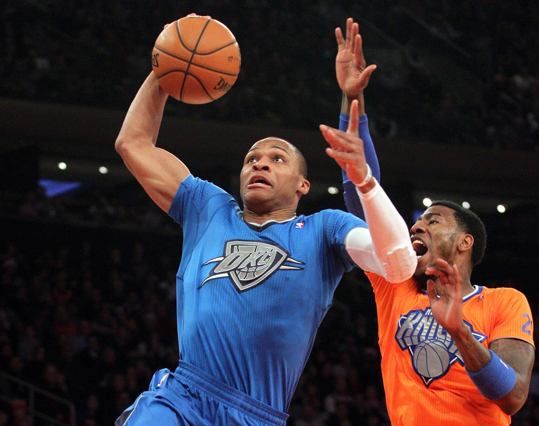 The Thunder's Russell Westbrook drives past the Knicks' Iman Shumpert during the first quarter.