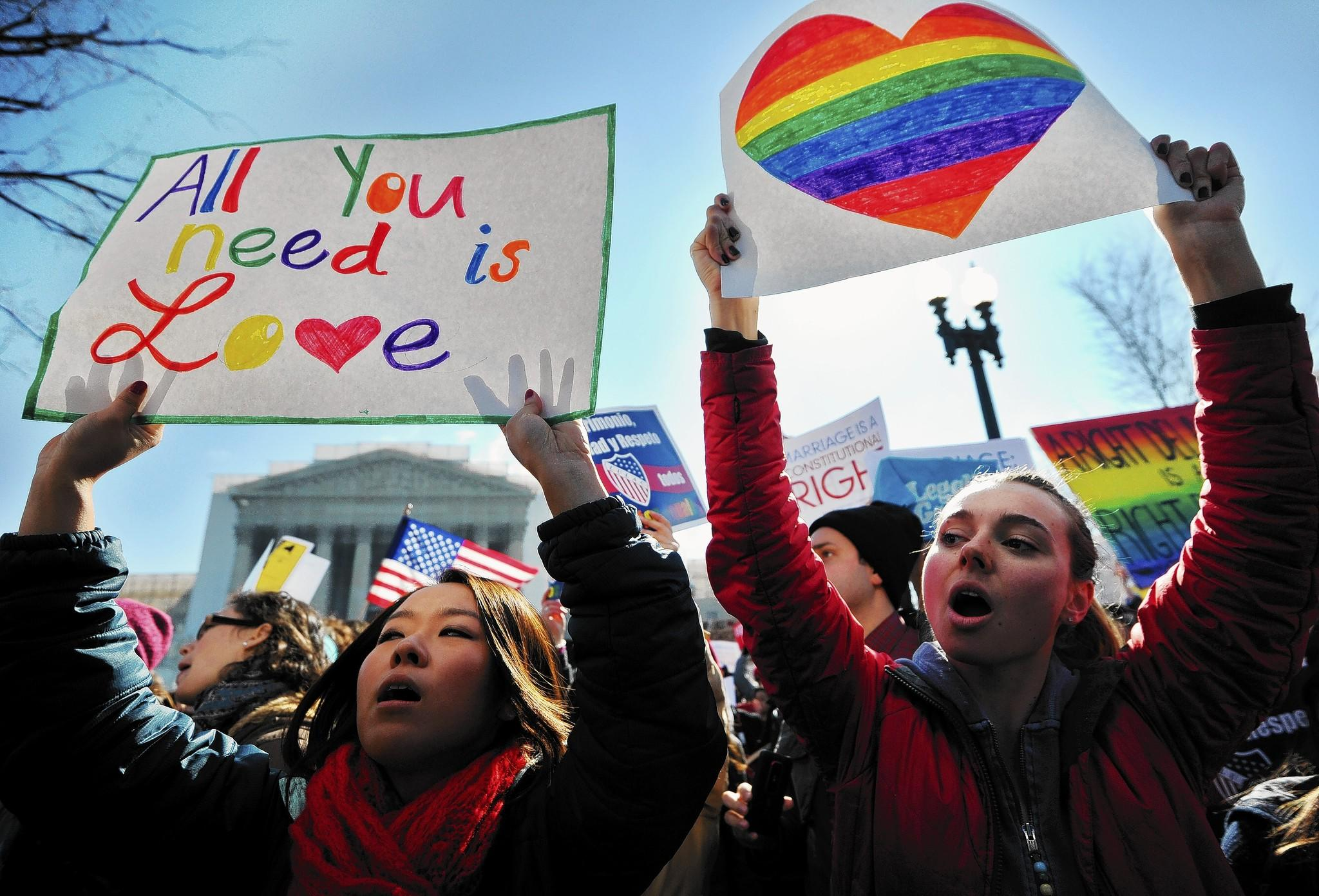 Same-sex marriage supporters, shown at a rally in front of the Supreme Court in Washington in March, were enthusiastic after the court issued two opinions favorable to their cause.