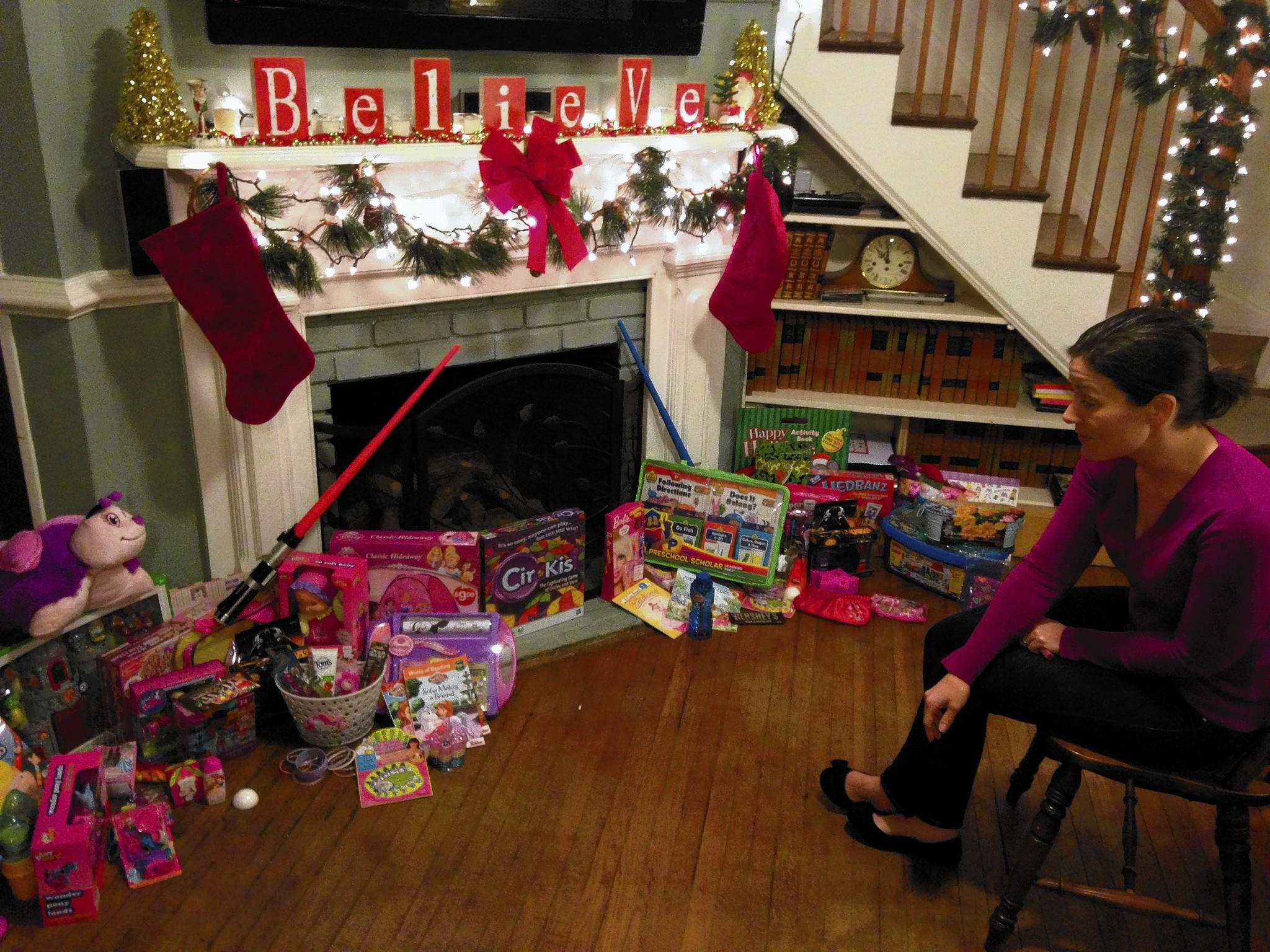 Alexis Chappell points to some of the gifts that showed up at her doorstep that her girls had actually asked for.