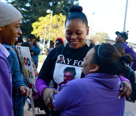 Nailah Winkfield, center, mother of Jahi McMath, receives hugs and support from family.