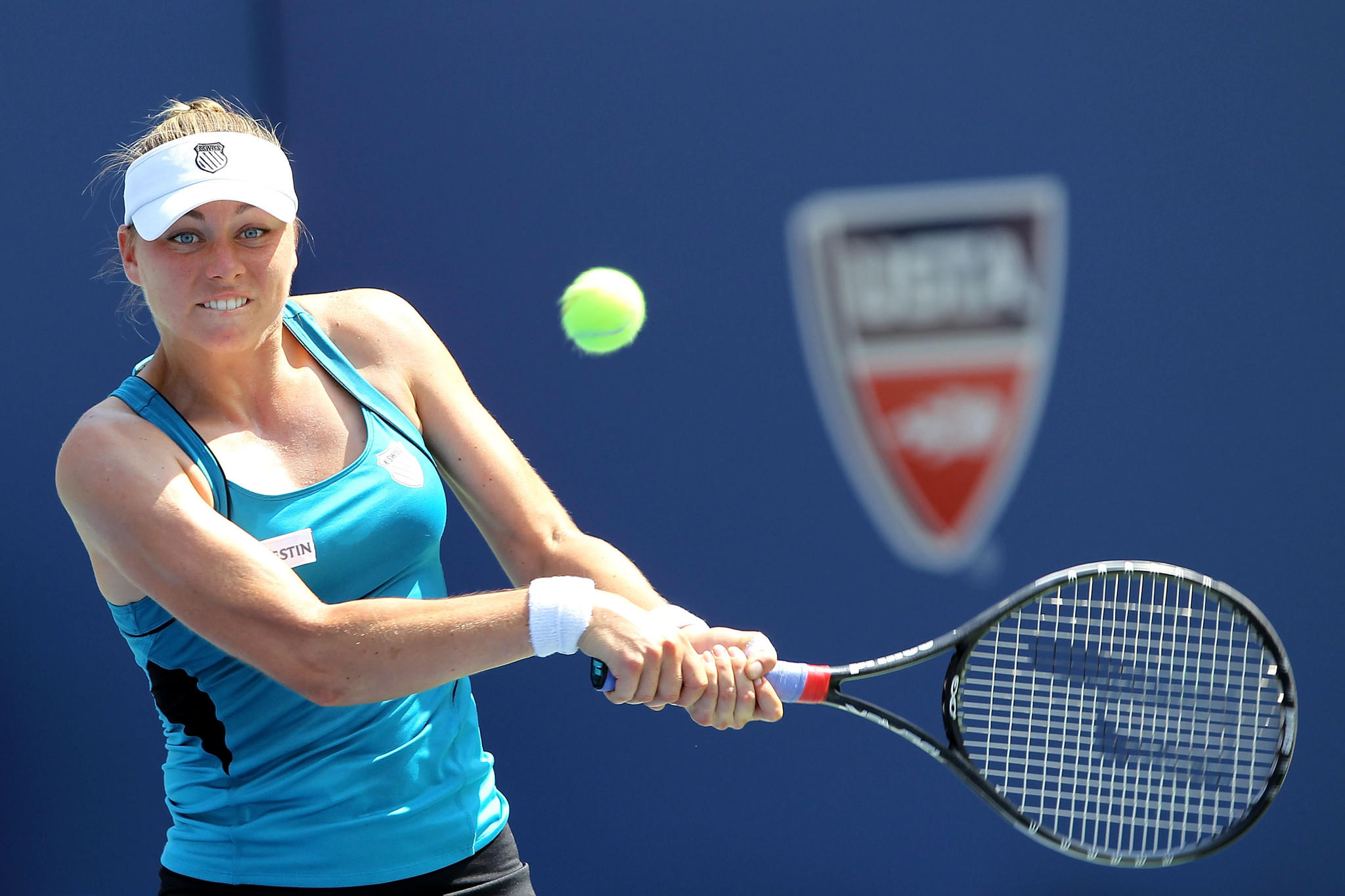 NEW YORK, NY - SEPTEMBER 02: Vera Zvonareva of Russia returns a shot against Anabel Medina Garrigues of Spain during Day Five of the 2011 US Open at the USTA Billie Jean King National Tennis Center on September 2, 2011 in the Flushing neighborhood of the Queens borough of New York City.