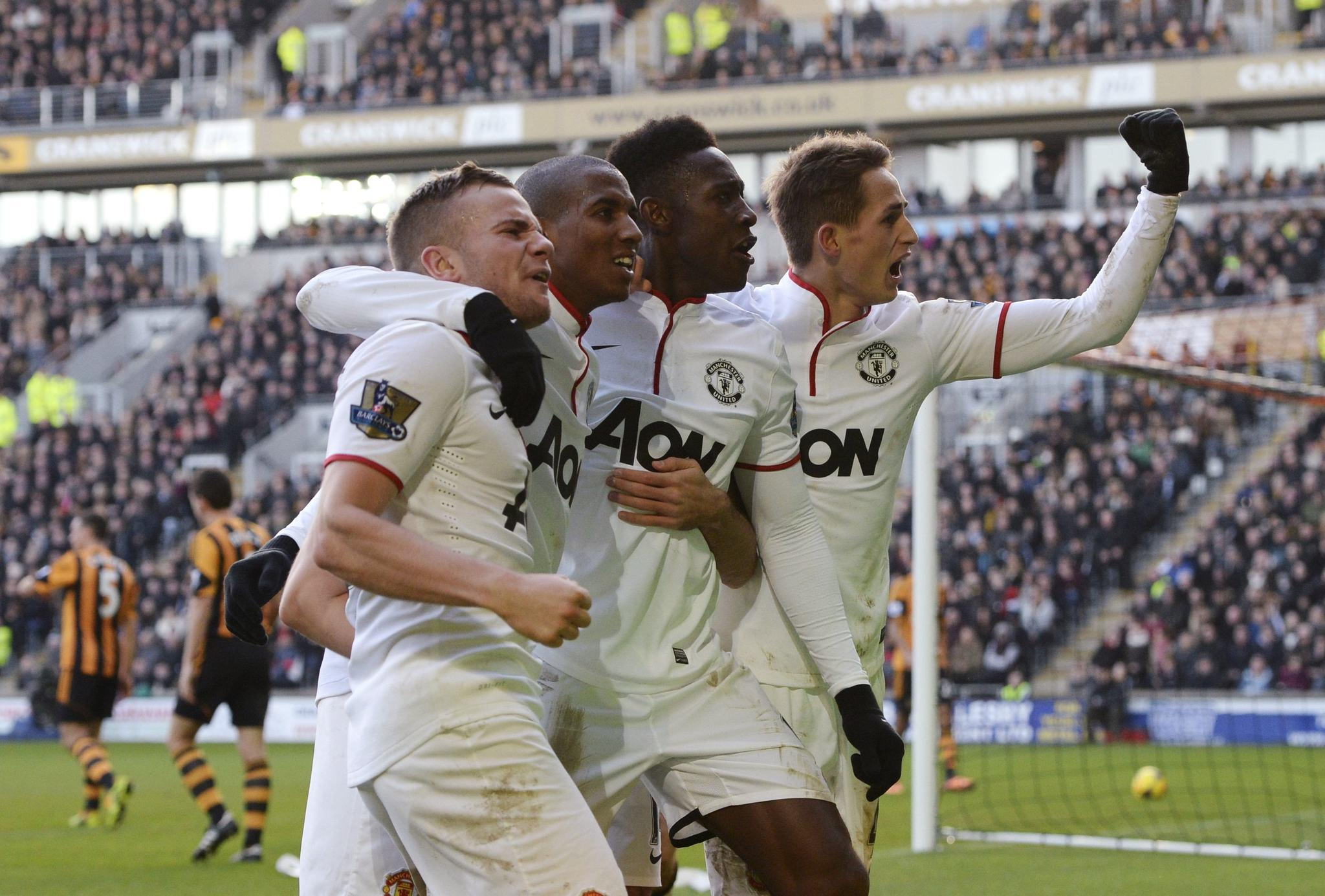 Manchester United players (L-R) Tom Cleverley, Ashley Young, Danny Welbeck and Adnan Januzaj celebrate an own goal by Hull City's James Chester (not pictured) during their English Premier League soccer match at the KC Stadium in Hull, northern England December 26, 2013. REUTERS/Nigel Roddis