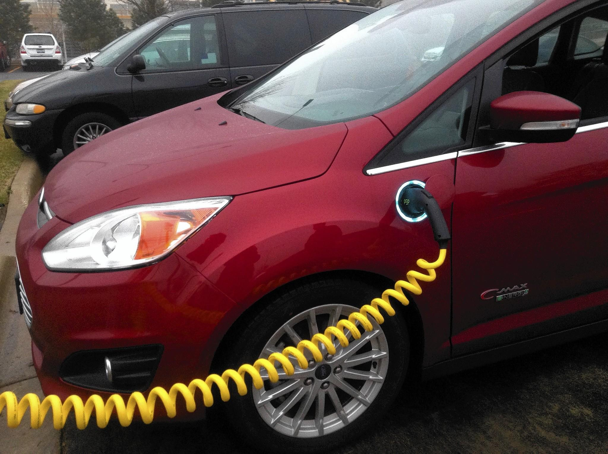 A car charges at the College of DuPage's first electric car charging station. Another will be installed in the spring.