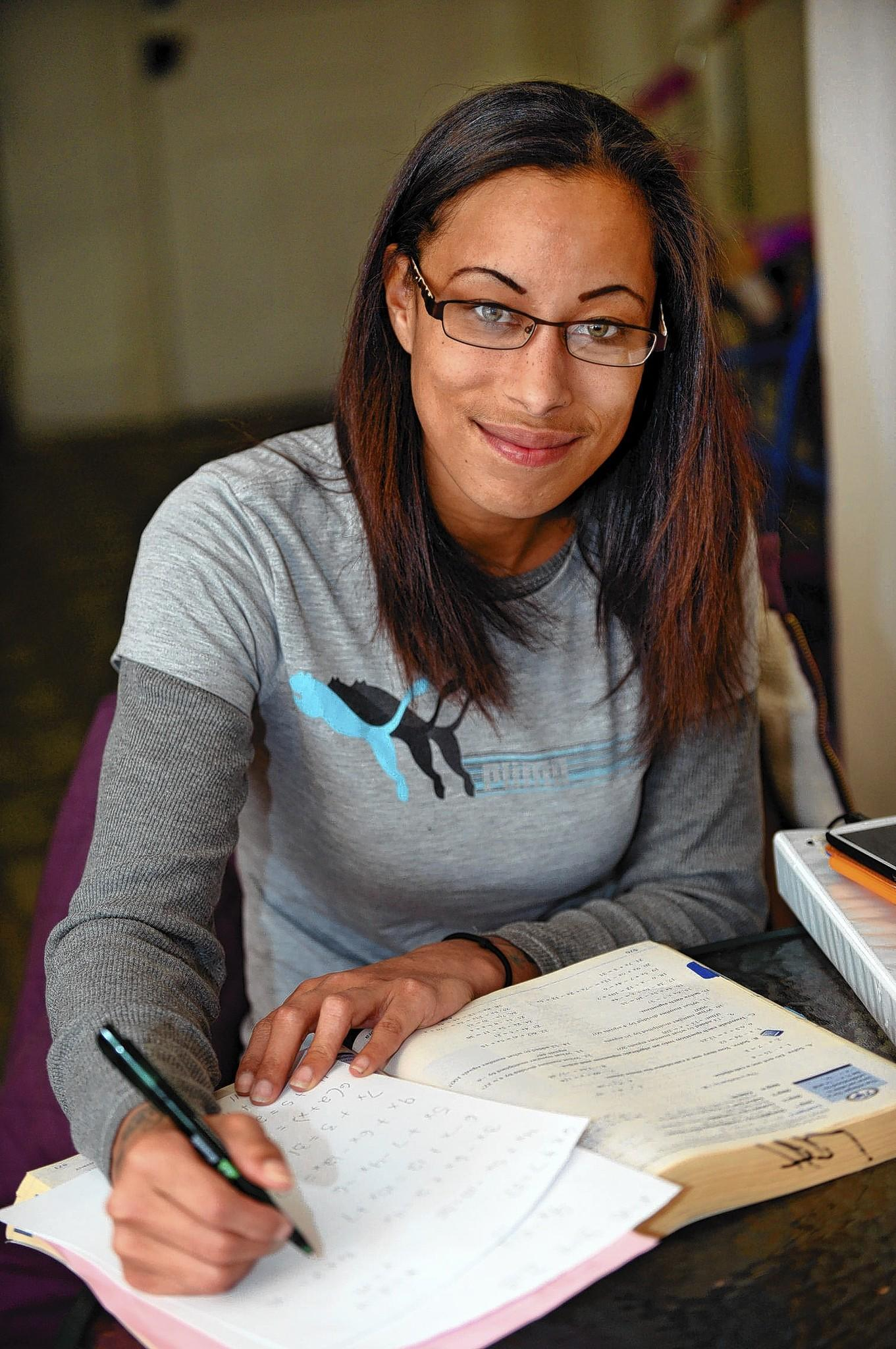 Sequoia Dennis of Allentown studies math in her home in preparation for taking the GED. She took and passed the final two parts of the high school equivalency test on Dec. 19 -- before a new tougher version of the test begins in January.