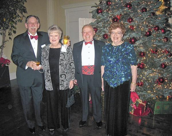 Jack and Barbara Stocky, from left, and Frank Osmon and Joanne Stebenne are all smiles at the Stardusters and Alaroma dance clubs joint Christmas party.
