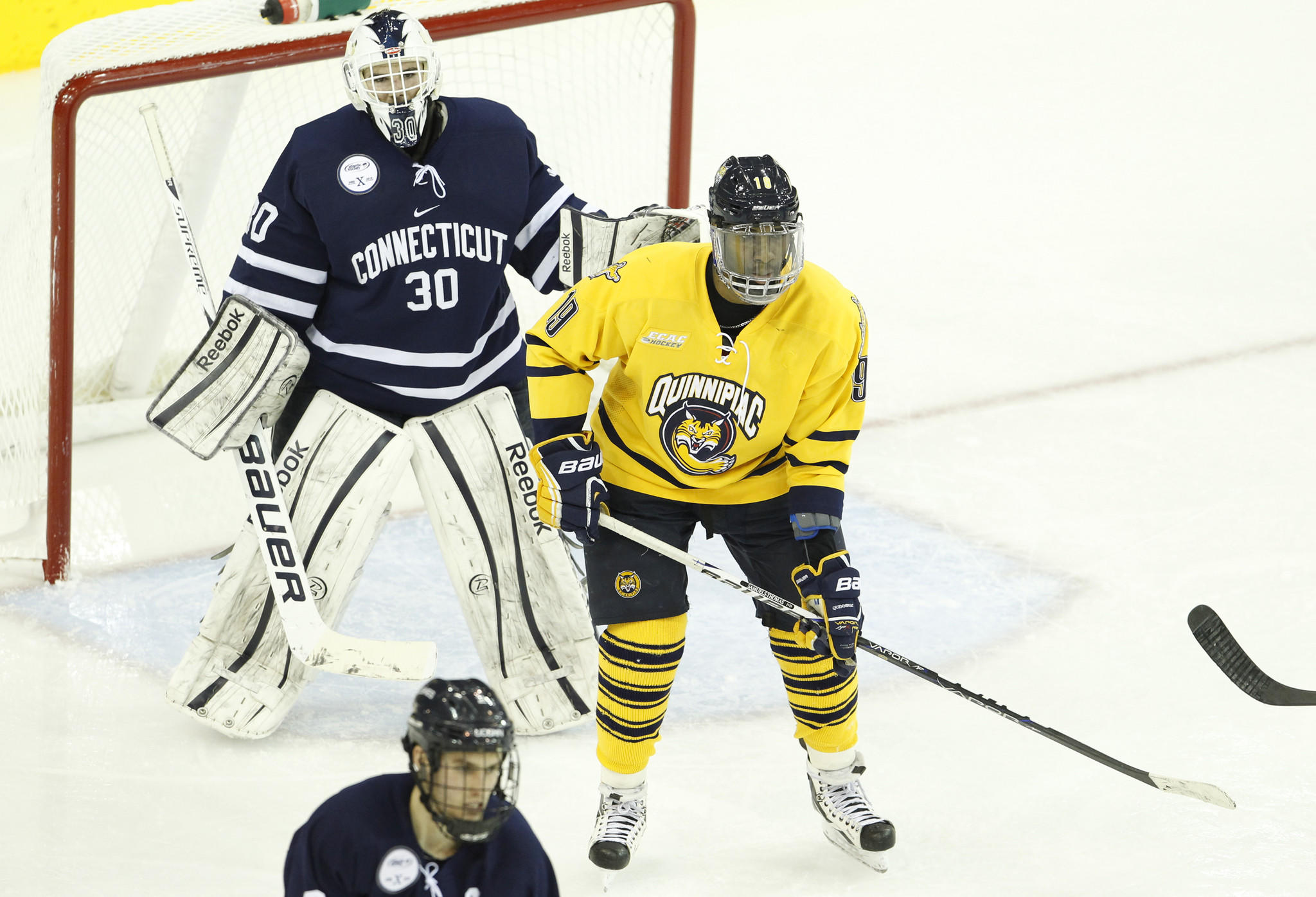Hamden, CT 01/22/13; Connecticut Huskies goaltender Matt Grogan (30) watches the play with Quinnipiac Bobcats forward Jordan Samuels-Thomas (19) during the third period at the TD Bank Sports Center. Quinnipiac defeated UConn 2-1. photo by David Butler II