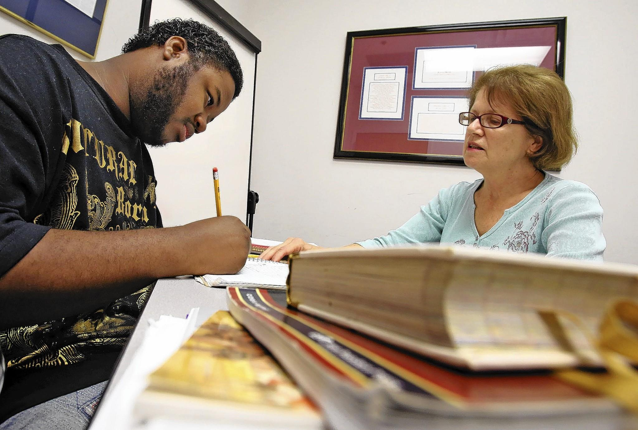 Jeremy White, 23, of Orlando works on writing skills with Marianne McKinney, a volunteer tutor at Adult Literacy League in Orlando.