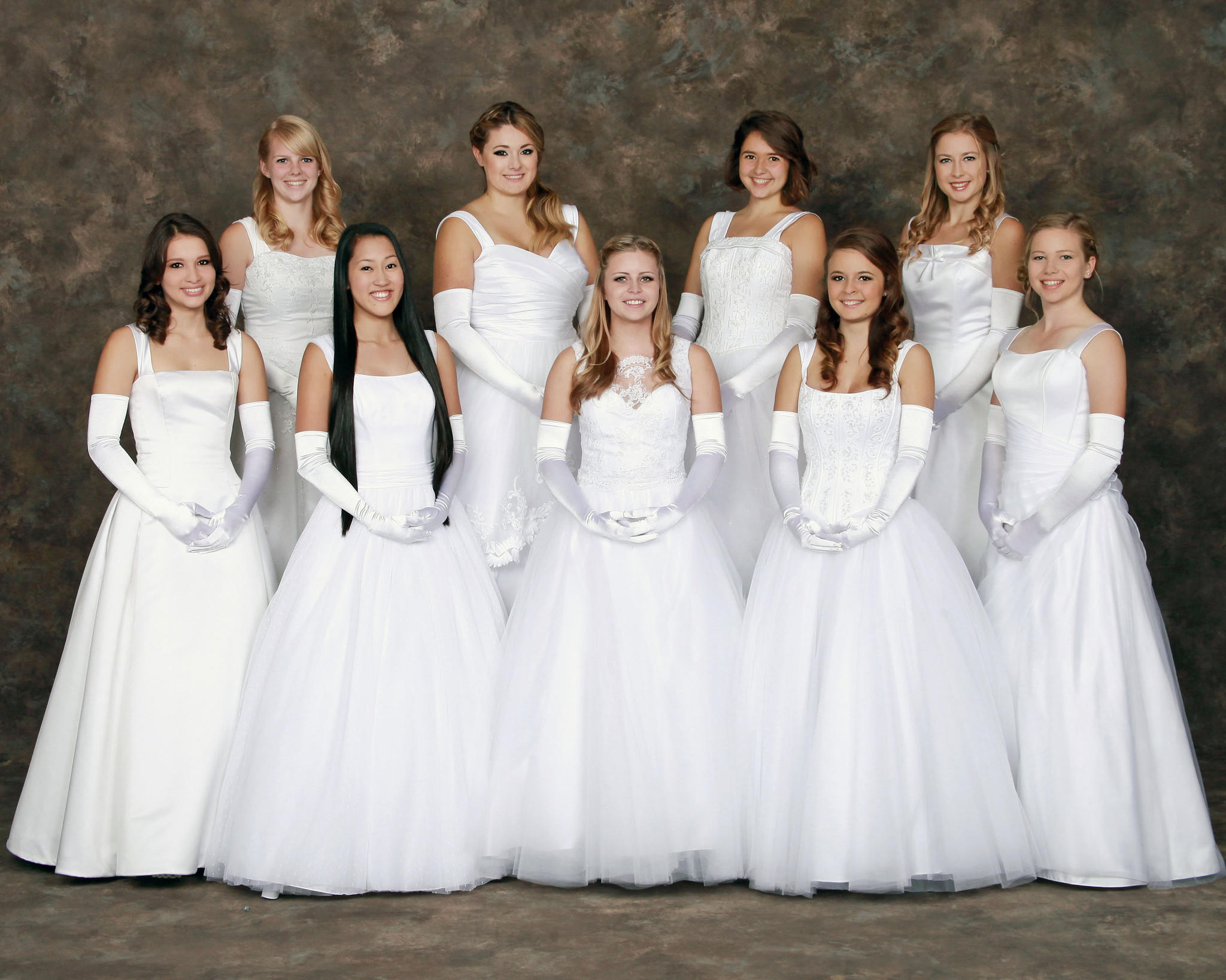 Some of the 2013 Les Fleurettes preparing for the Bal Blanc de Noel Saturday night are (front row, left to right) Shannon Ritter, Adelle Higley, Grace Vallen, Alessandra Koeppen, and Madelyn Merchant. (back row, left to right) Tracey Andrews, Charlotte Leddie, Galey Caverly and Haley Johnson.