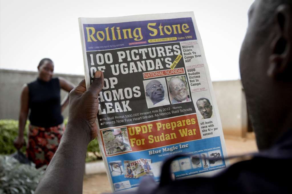 A man is seen in 2010 reading the headline of the Ugandan newspaper Rolling Stone in which the paper reveals the identity of allegedly gay members of Ugandan society and calls for public punishment. An anti-homosexuality bill awaits the Ugandan president's signature or veto.