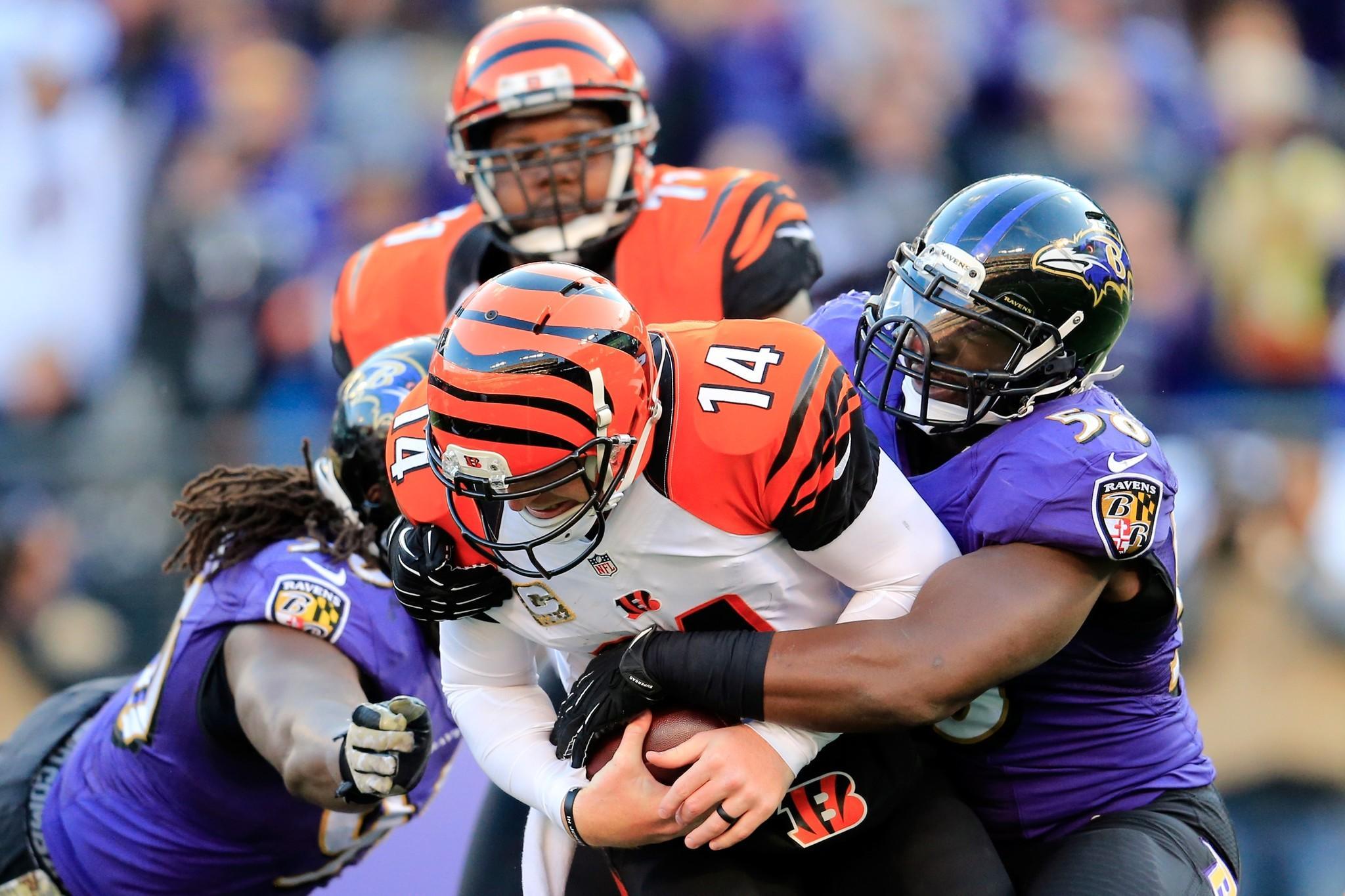 Ravens linebacker Elvis Dumervil sacks Bengals quarterback Andy Dalton in the first meeting between the teams in November.