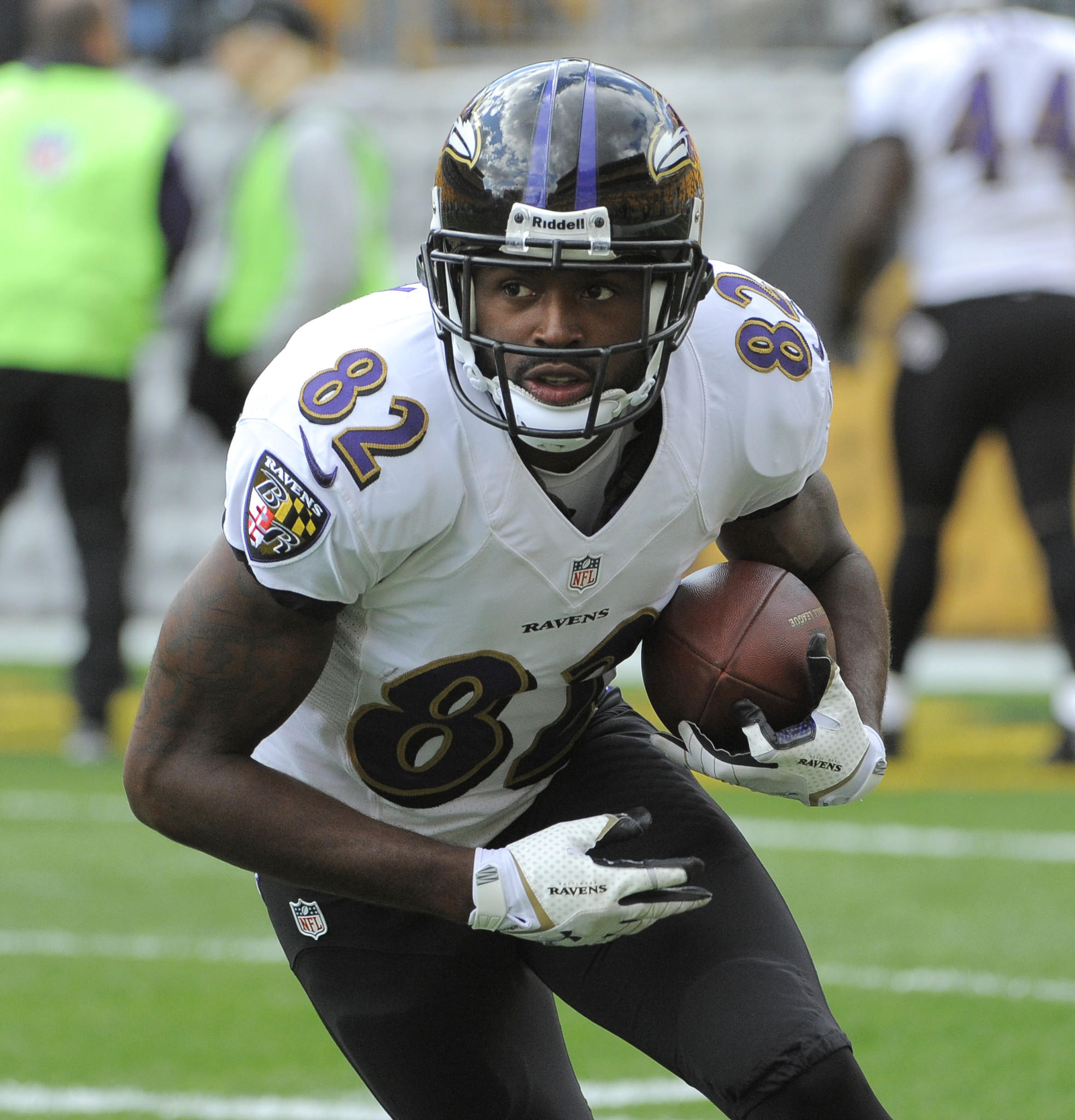 Ravens wide receiver Torrey Smith grabs a pass during warmups in October.