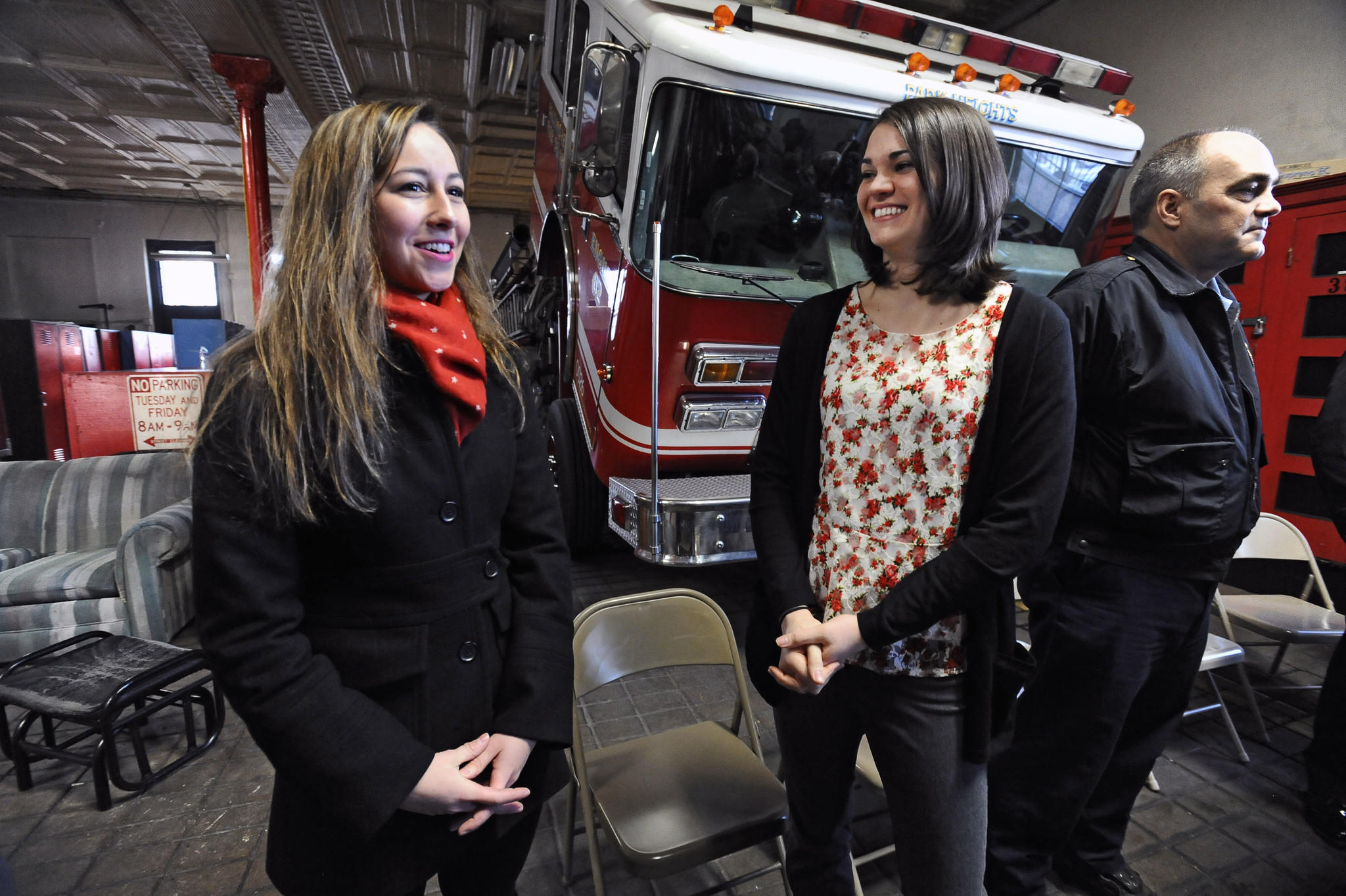 Summer Britcher, 19, center, meets Former Olympics skater Kimmie Meissner, left, for the first time. Britcher, a member of the US Olympic luge team who will compete in singles luge at the Winter Olympics in Sochi, Russia, gets well wishes and a send off from the Baltimore Fire Department at Engine Company #29 on Park Heights Avenue. Her father William Britcher, right, is a captain at the station. Kimmie Meissner and her parents also attended the media event.