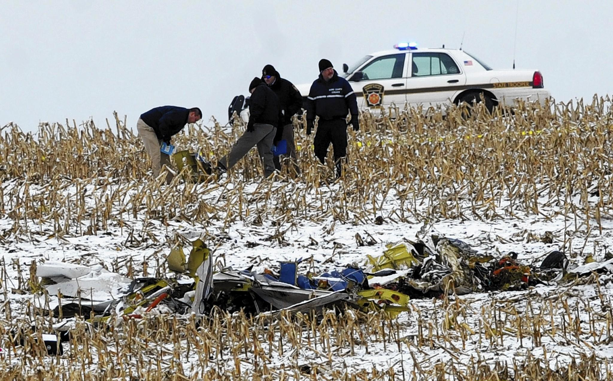 A reported plane crash is investigated in a Butler Township cornfied on Thursday, Dec. 26, 2013.