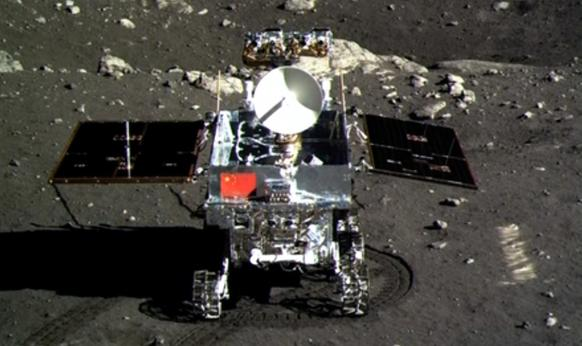 Television footage shows a photo of China's Jade Rabbit lunar rover taken by the Chang'e 3 probe lander on Dec. 15.