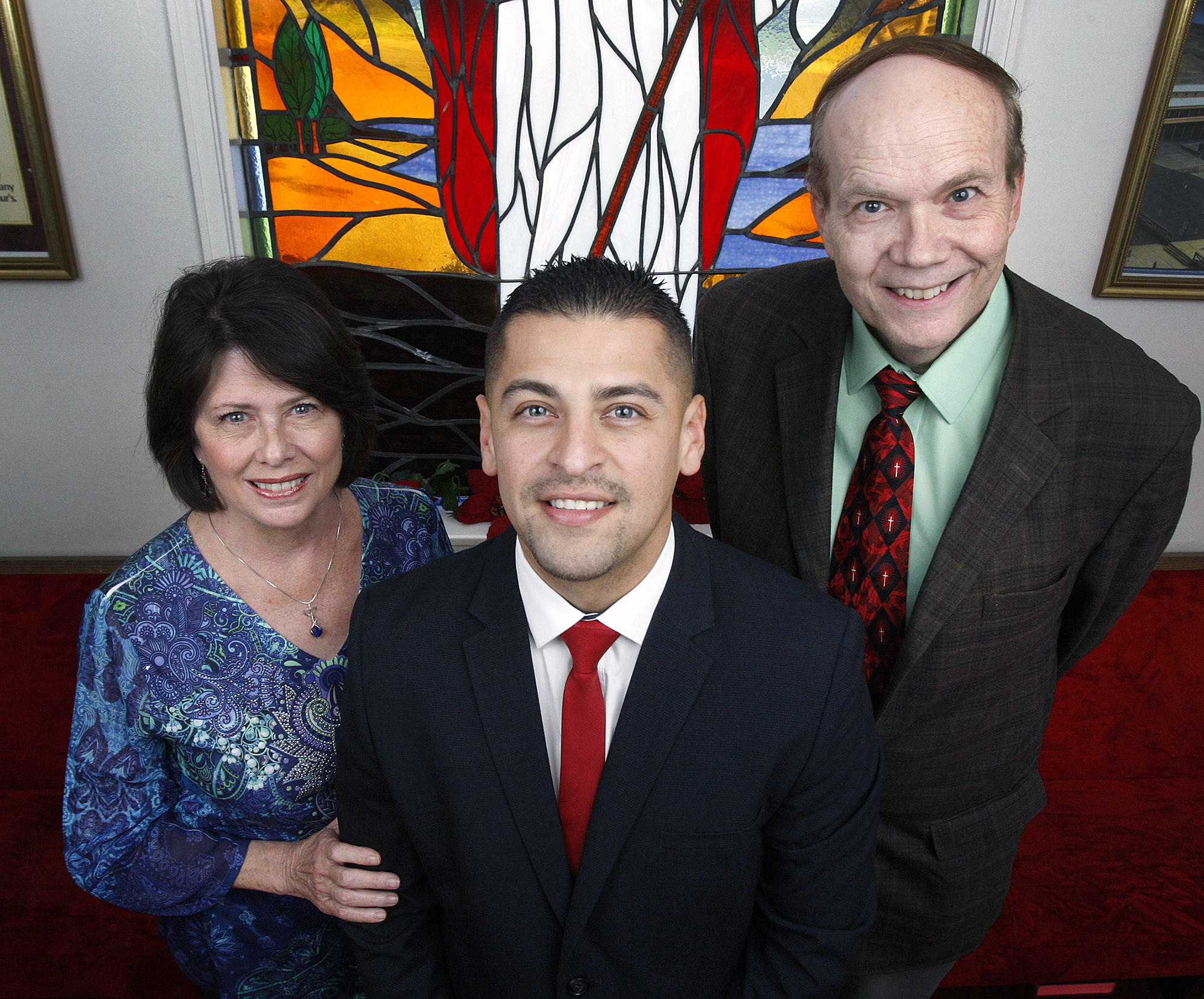Joseph Cordova, in front, with Cathy Keen, and Dr. Ronald Vandermey, co-Pastor of Bethany Bible Presbyterian Church in Montrose inside the church on Monday, December 23, 2013. About 10 years ago, when Cordova's life was at a low point, Vandermey took him to the USC school of dentistry to have substantial work done on Cordova's teeth. There, he met Keen who has been his mentor and mom ever since, filling a need Cordova had after his parents died, and grandparents neglected.