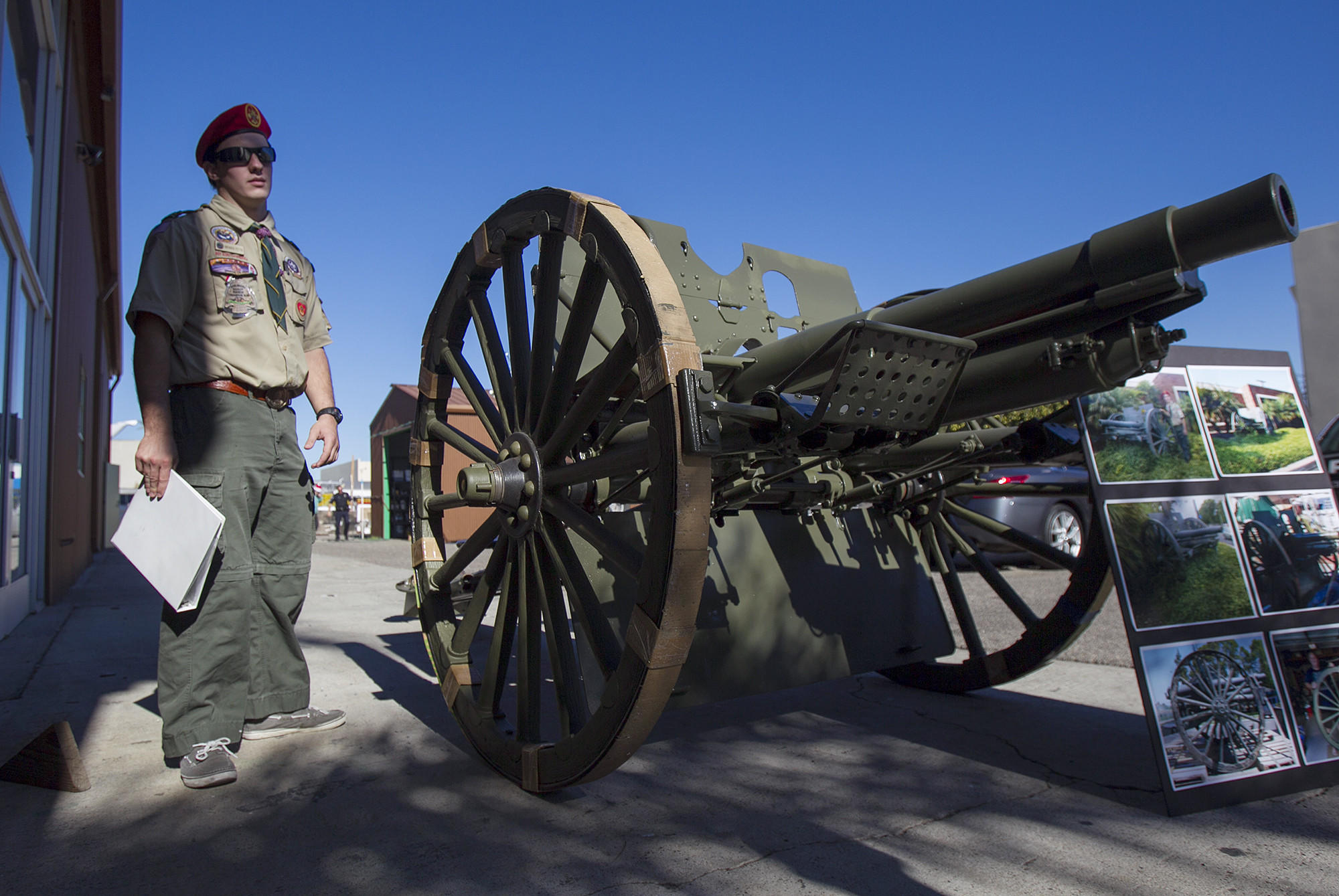 Brenden Fettis, 17, stands next to the US Army M1902 field gun that he restored as his Eagle Scout project. The gun will go back to its home in front of the Costa Mesa Police Department sub station on 18th Street. Photo taken on Thursday, December 26. (Scott Smeltzer, Coastline Pilot)