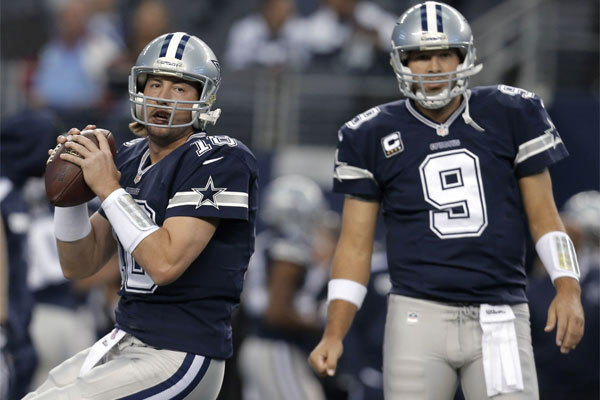Dallas quarterbacks Kyle Orton, left, and Tony Romo warm up before the Cowboys' game against Oakland on Nov. 28.
