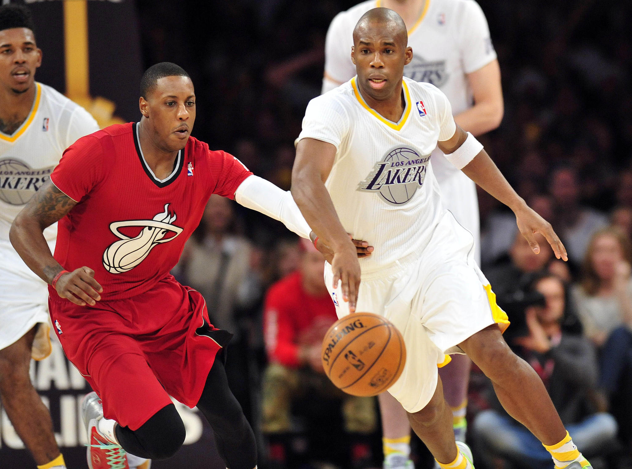 December 25, 2013; Los Angeles, CA, USA; Los Angeles Lakers shooting guard Jodie Meeks (20) moves the ball ahead of Miami Heat point guard Mario Chalmers (15) during the second half at Staples Center. Mandatory Credit: Gary A. Vasquez-USA TODAY Sports ORG XMIT: USATSI-140316