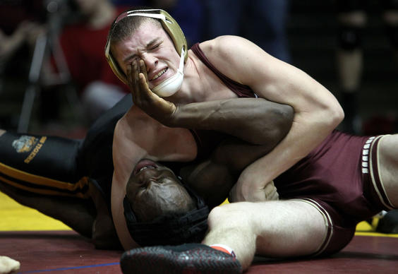 Antwuan Hicks of Tabb tries to keep from getting pinned by Brandon Steffens of Poquoson in the 170 pound match Saturday at the Virginia Duals. Steffens got the win. No Mags, No Sales, No Internet, No TV