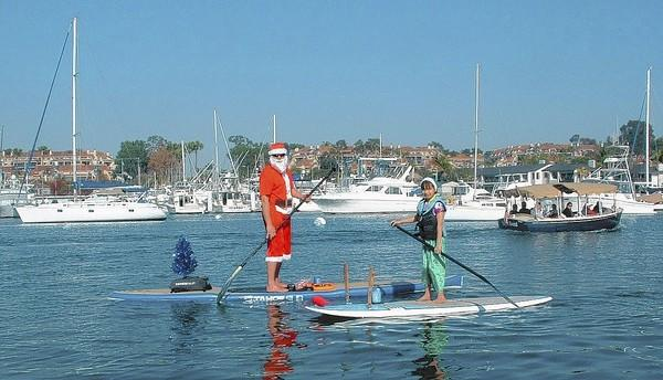 Rob and Haden McIntosh spreading holiday cheer, Newport Beach style.