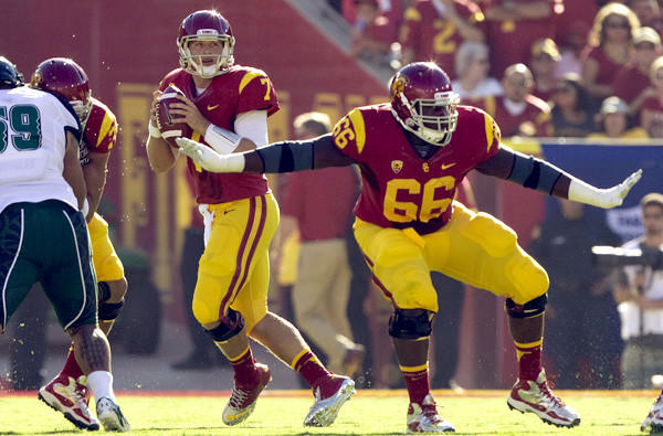 Marcus Martin (66) started two seasons at guard and one season at center for the Trojans.