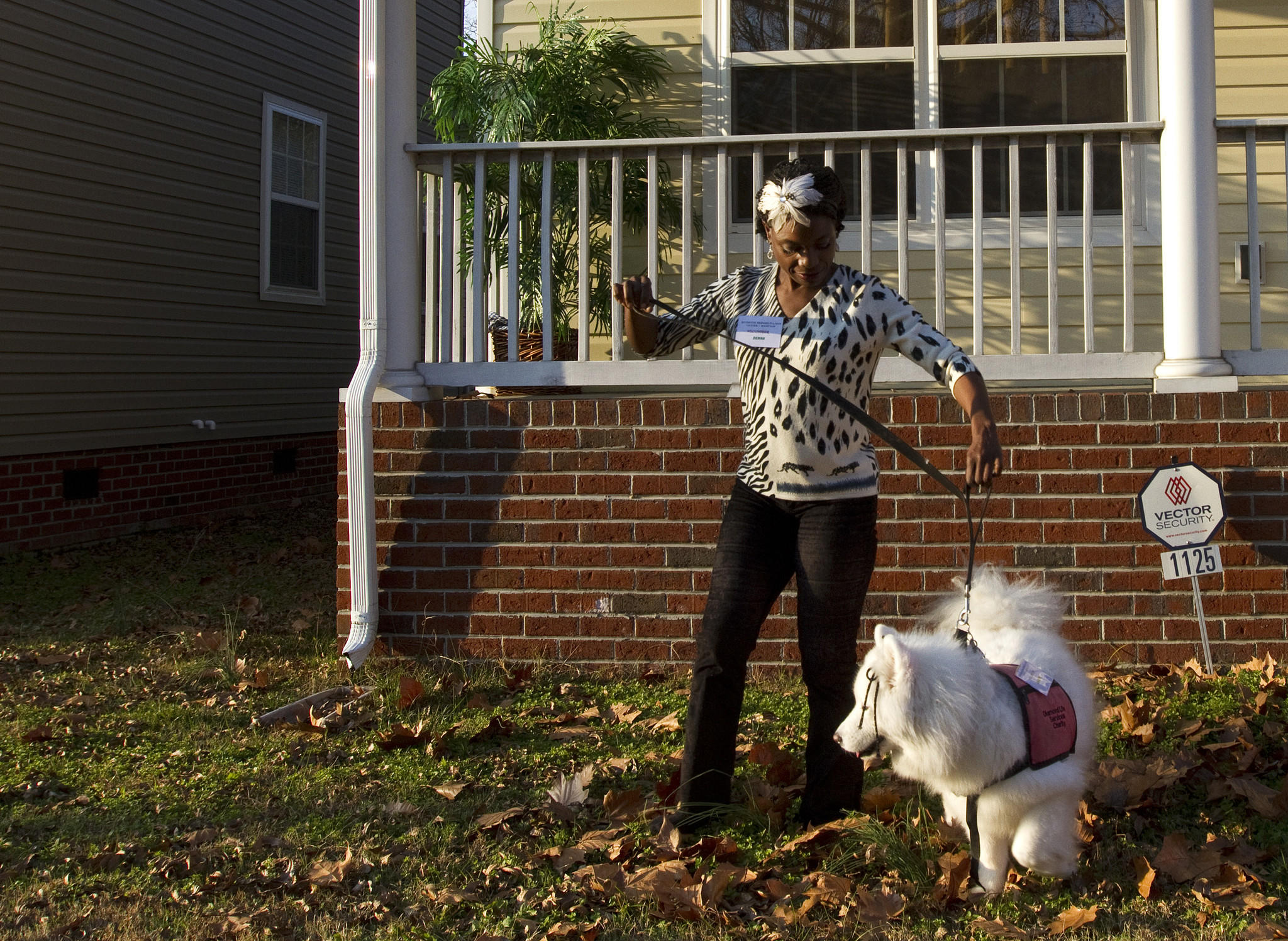 Denna Williams walks with her service dog, Diamond, at home in Newport News on Dec. 3. Diamond will soon be retired and adopted by a new family.