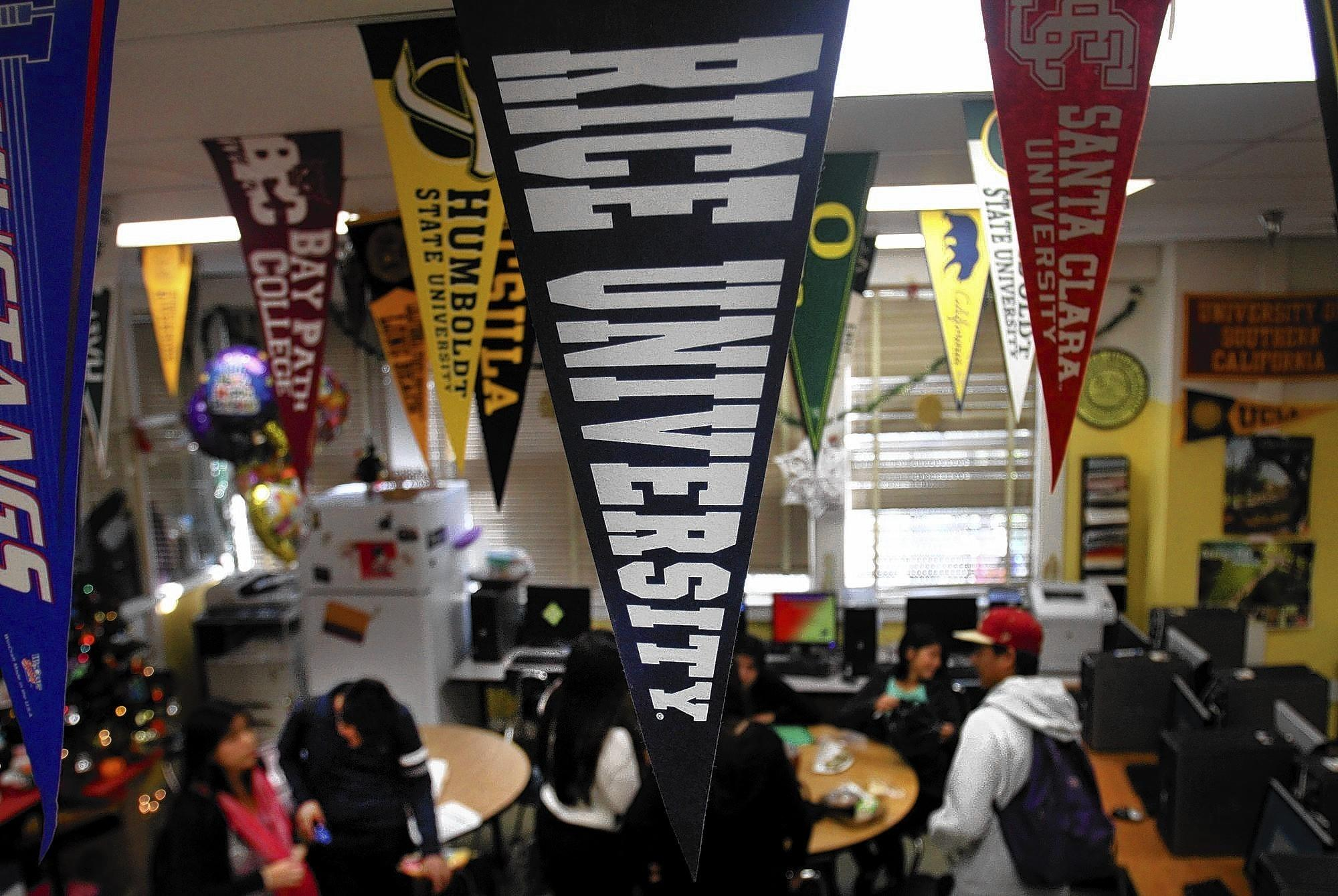 Students gather in college counselor Teresa Carreto's room at Roosevelt High in L.A.'s Boyle Heights, one of the area campuses receiving relatively few visits from college counselors.